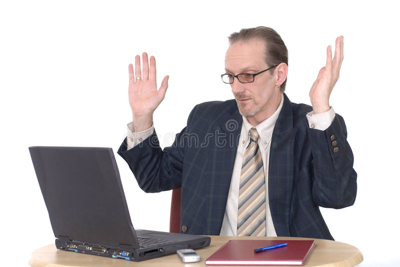 Surprised looking Businessman working on laptop royalty free stock photography