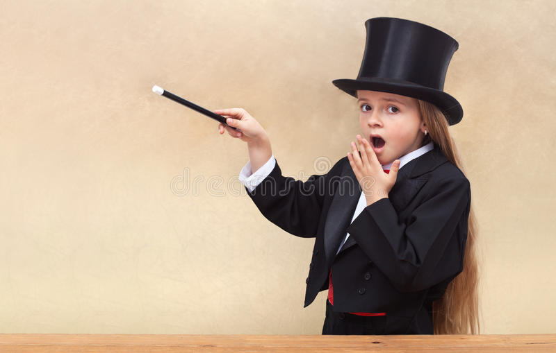 Surprised magician girl with magic wand royalty free stock images