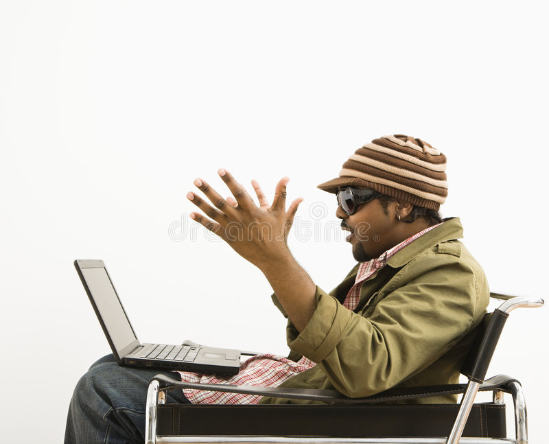 Surprised man with laptop. royalty free stock photos