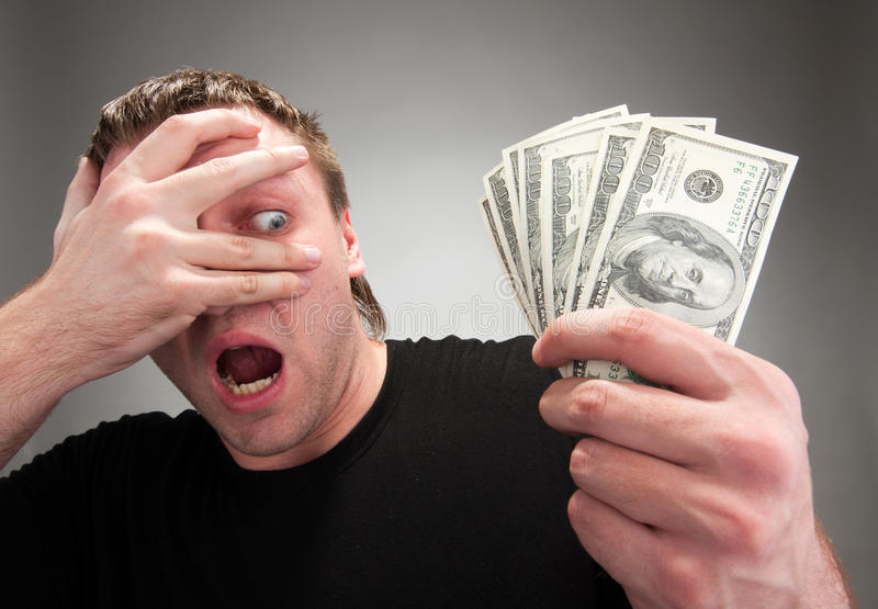 Surprised Man With Money Royalty Free Stock Photography