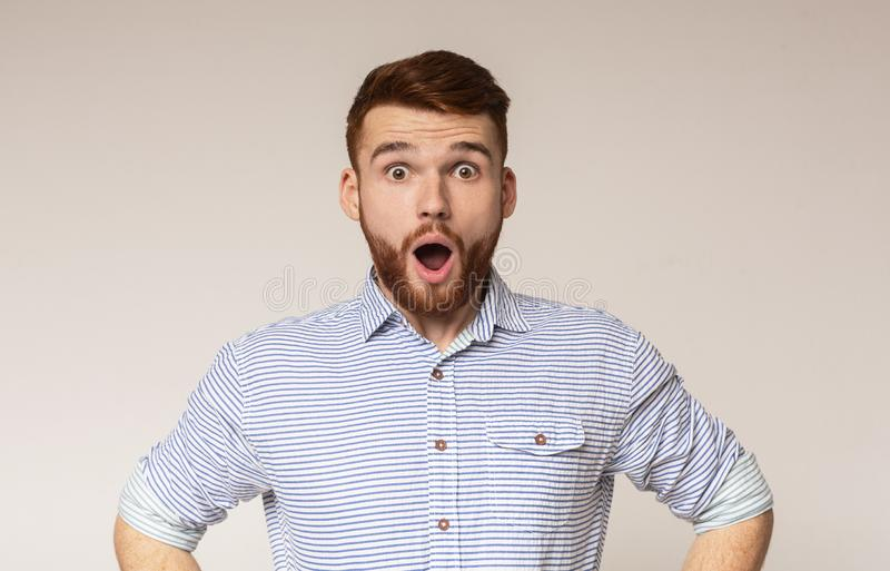 Surprised man with shocked look on studio background royalty free stock photography