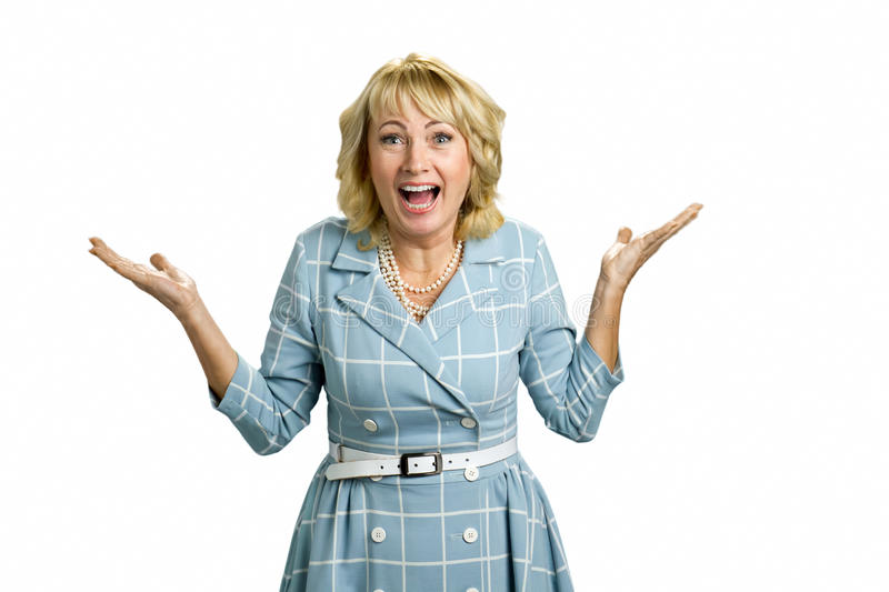Surprised mature woman raised hands. royalty free stock photos