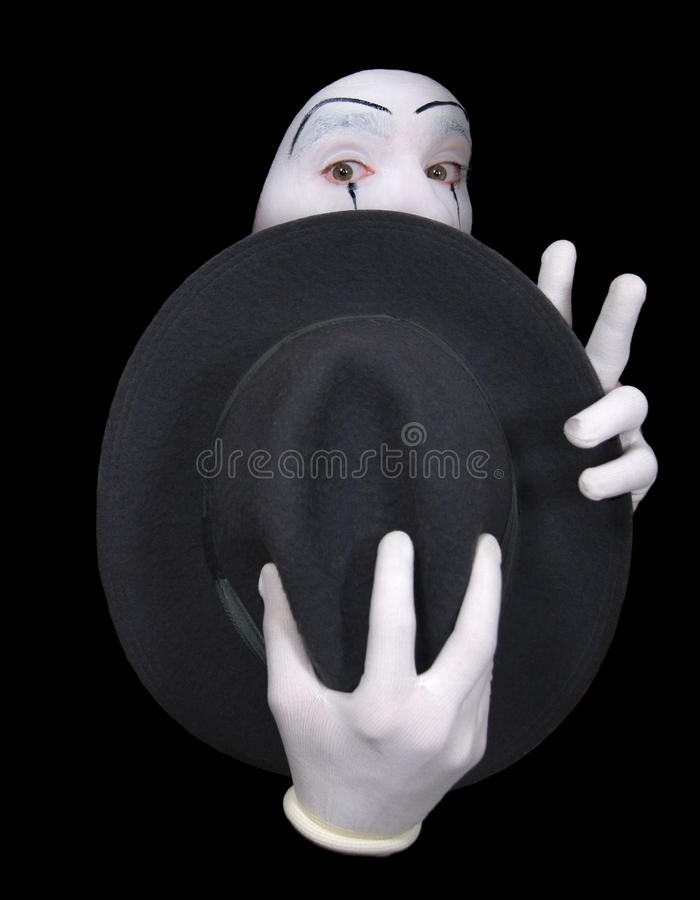 Surprised mime with a hat. Surprise mime with a hat on a black background royalty free stock photos