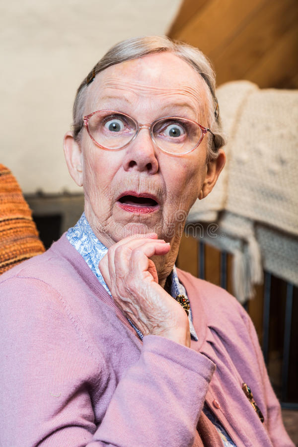 Surprised Old Woman. Surprised old matron woman looking at camera royalty free stock photo