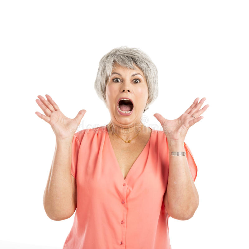 Surprised old woman. Portrait of a elderly woman surprised with something, isolated on a white background royalty free stock image