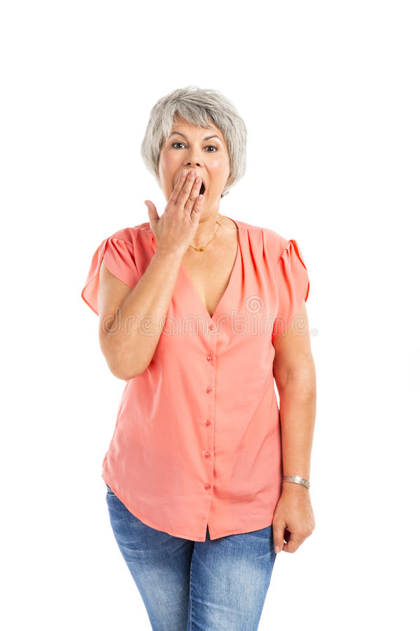 Surprised old woman. Portrait of a elderly woman surprised with something, isolated on a white background stock photo