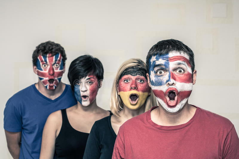 Surprised People With Flags On Faces Stock Photo - Image ...