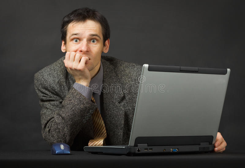 Download Surprised Person With Computer. Sits And Thinks. Stock Photo - Image: 15493878