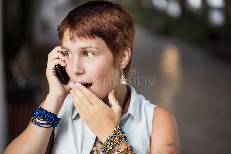 Surprised on the phone royalty free stock photo