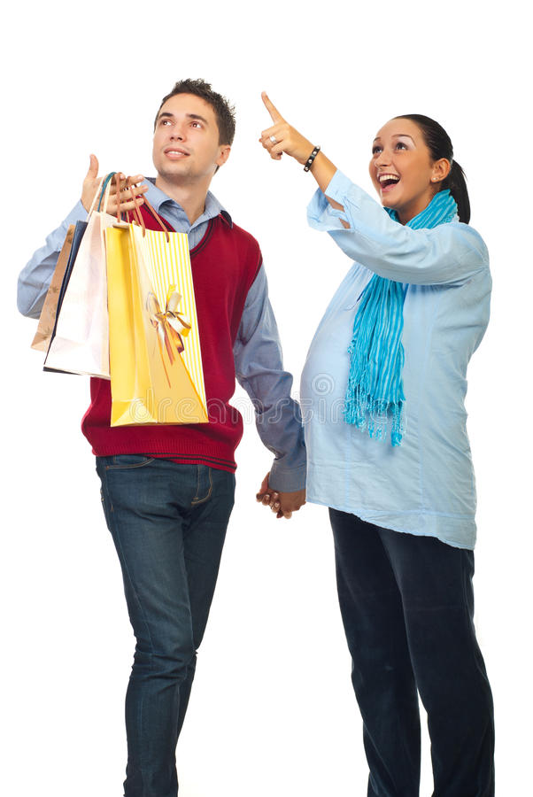 Surprised pregnant couple at shopping stock photography