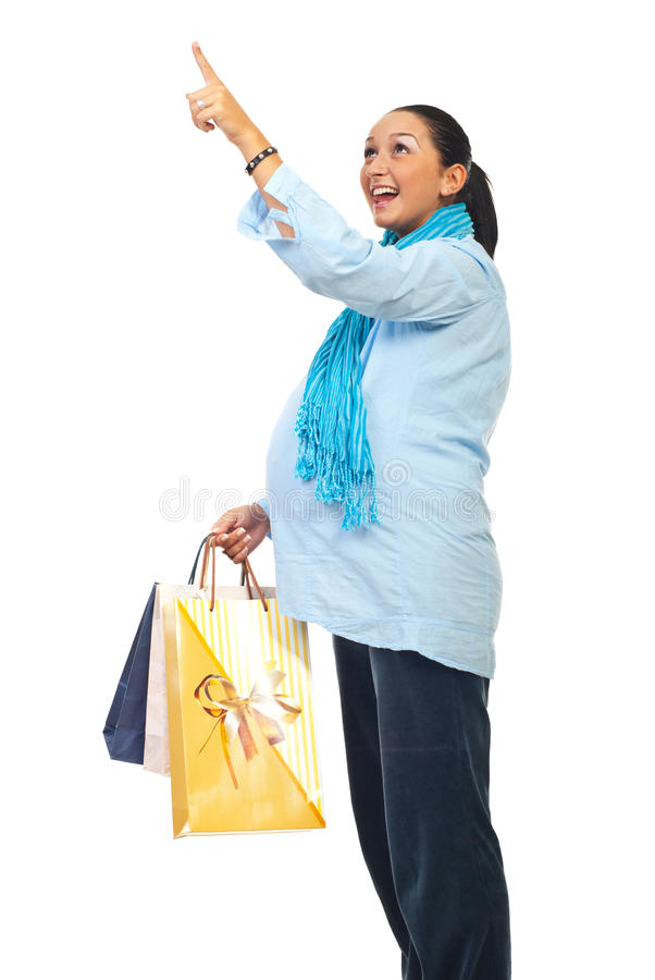 Surprised pregnant pointing at shopping royalty free stock photography