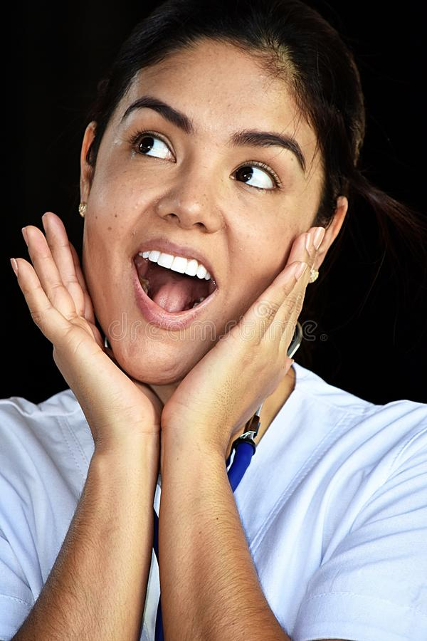 Surprised Pretty Female Nurse Medical Professional Wearing Scrubs stock photography