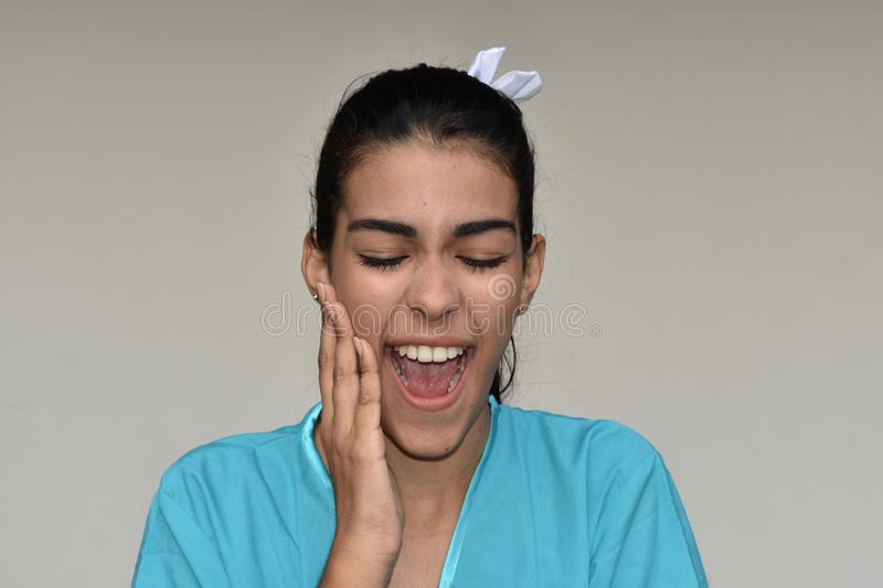 Surprised Pretty Female Nurse. A young pretty Colombian teenage girl stock photography