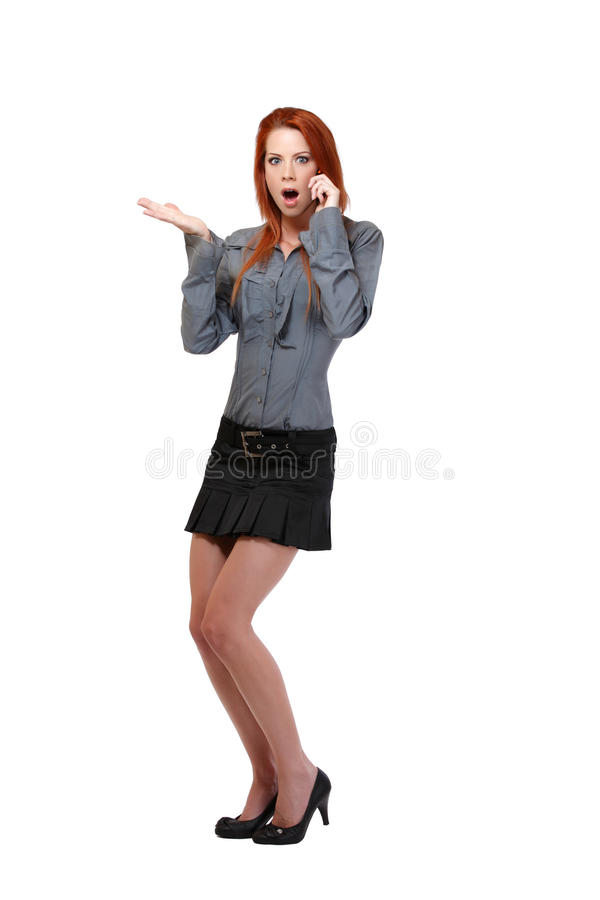 Download Surprised Redhead Woman Making A Call Stock Photo - Image of hear, grey: 25837400