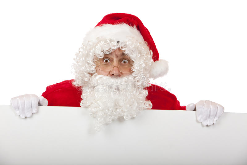 Surprised Santa Claus Holds Advertisment Board Stock Photography