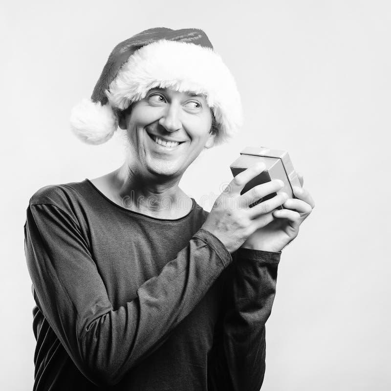 Surprised Santa man holding gift box. Santa christmas man isolated on white, copy space. Christmas holidays. Happy man enjoying stock photos
