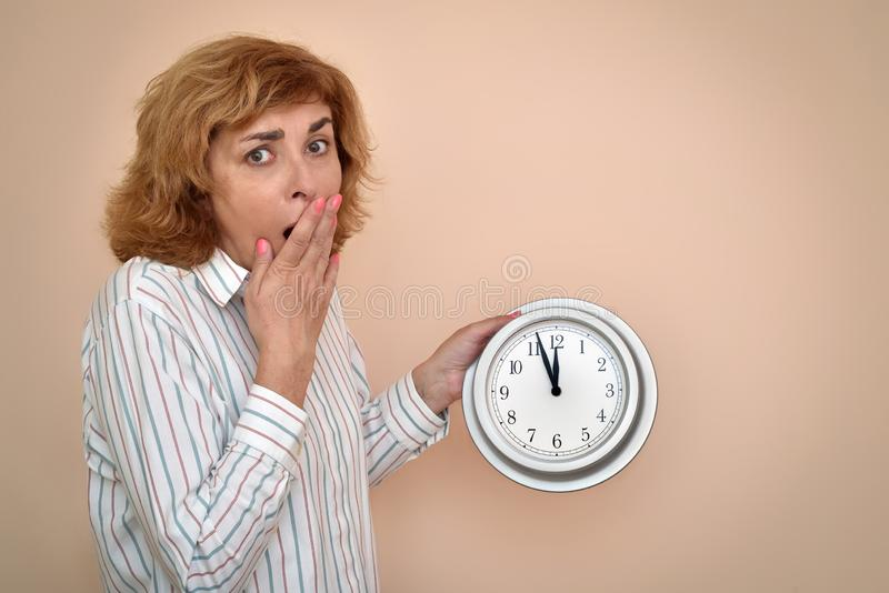Woman with a big clock royalty free stock photo