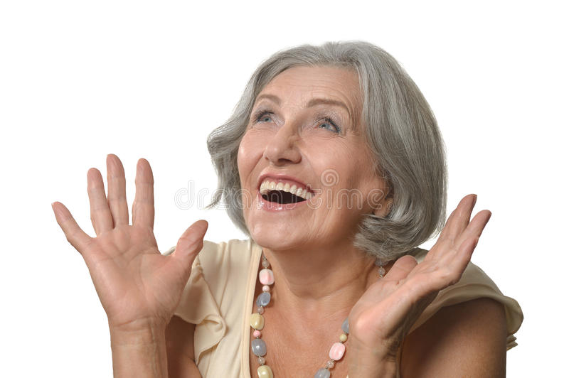 Surprised senior woman. Portrait of surprised senior woman on white background royalty free stock images