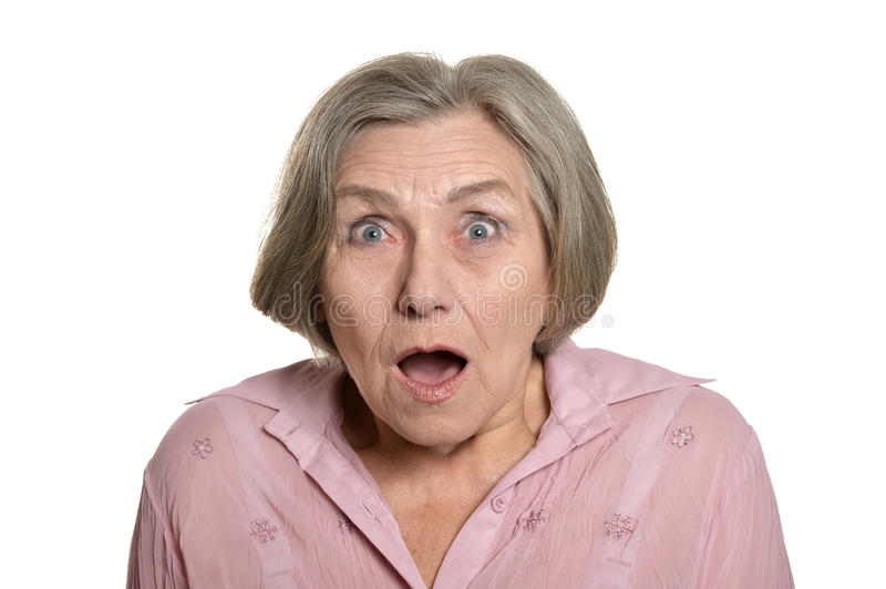 Surprised senior woman. Portrait of surprised senior woman on white background royalty free stock photography