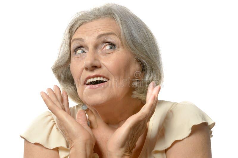 Surprised senior woman. Portrait of surprised senior woman on white background royalty free stock photos