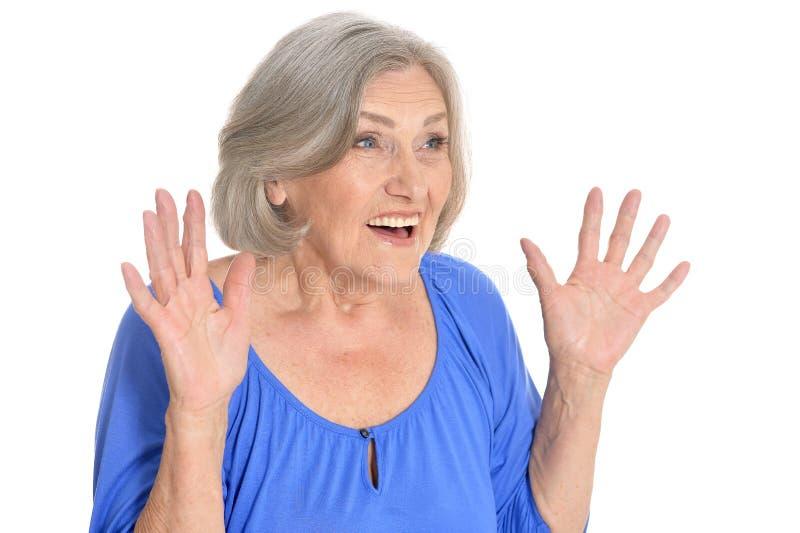 Surprised senior woman. Portrait of surprised senior woman on white background royalty free stock photo