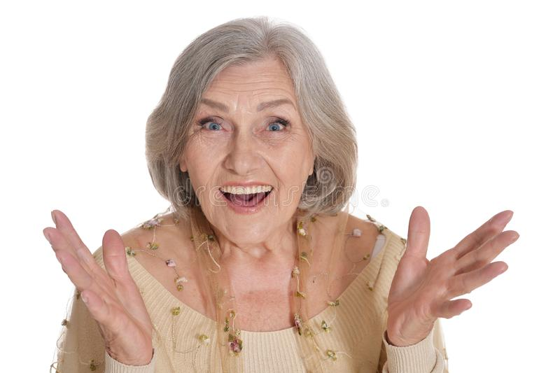 Surprised senior woman posing isolated on white background. Portrait of surprised senior woman posing isolated on white background royalty free stock images
