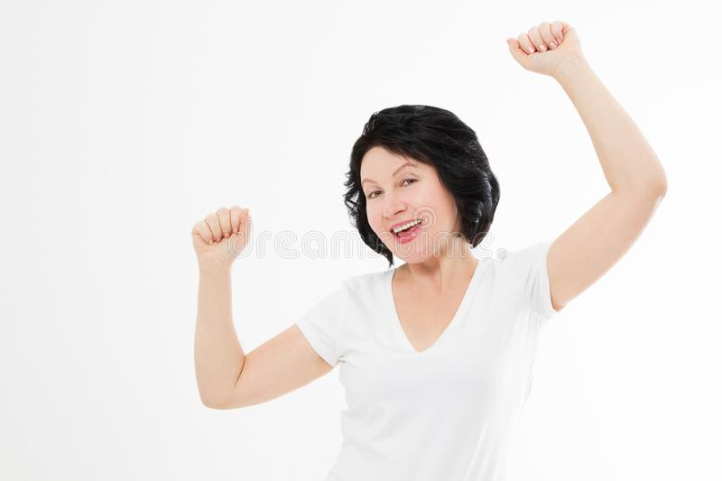 Surprised shocked excited asian middle age woman wrinkle face isolated on white background. Female in blank template t shirt stock images