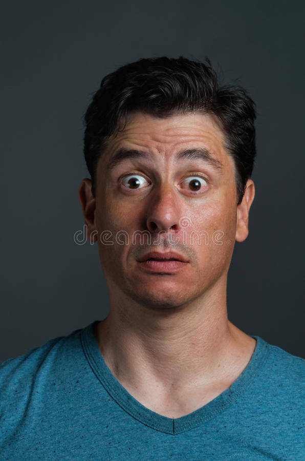 Surprised Shocked Man. Portrait of middle-age olive skinned Caucasian man with short dark eye and hair royalty free stock photo