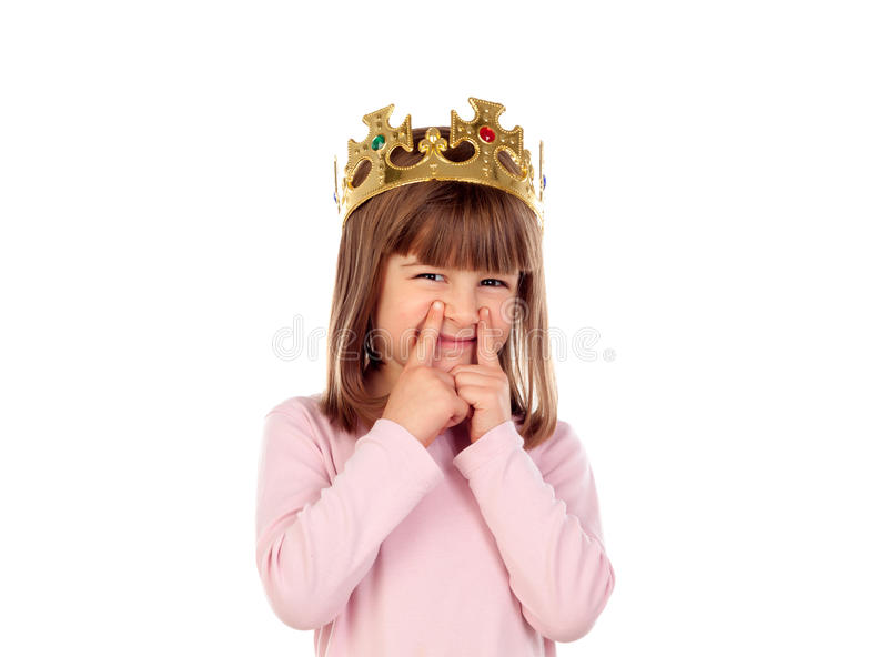 Surprised small girl wiht a golden crown making gestures stock images