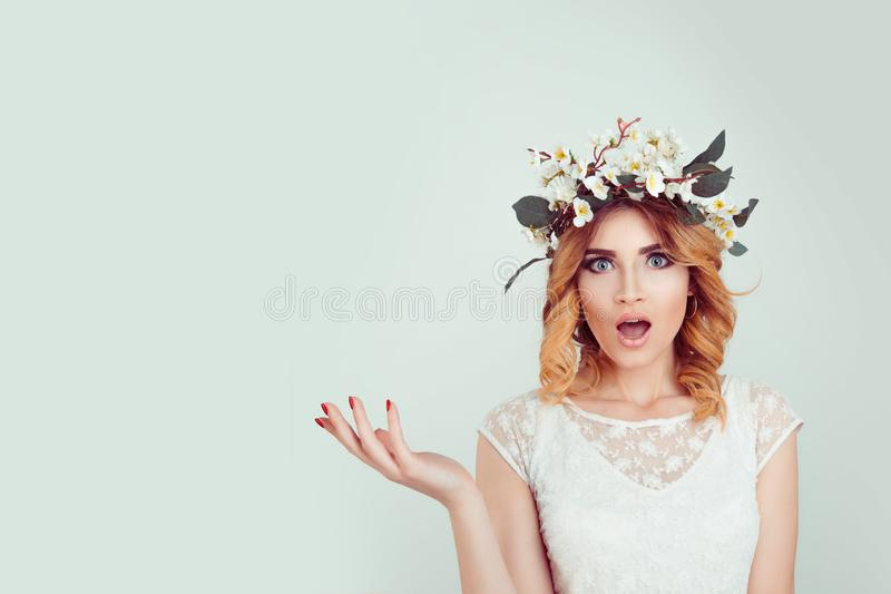 Surprised stunned woman in floral headband portrait royalty free stock images