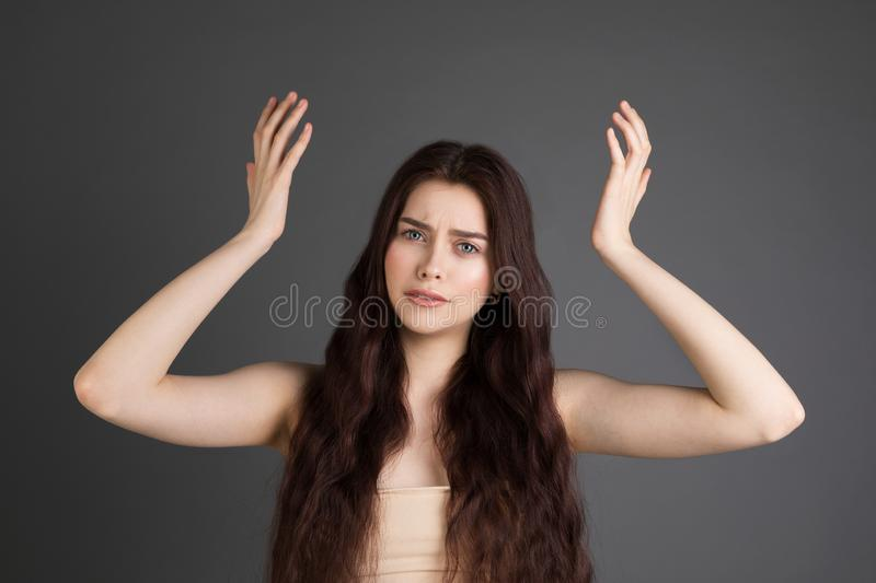 Surprised terrified female gestures with uncertainly, puzzled as doesn`t know answer on trick question. People, body language, emotions concept royalty free stock photos