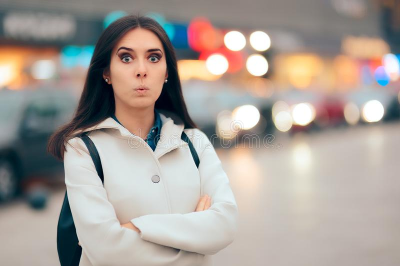 Surprised Urban Woman and City Lights Background Portrait stock photo