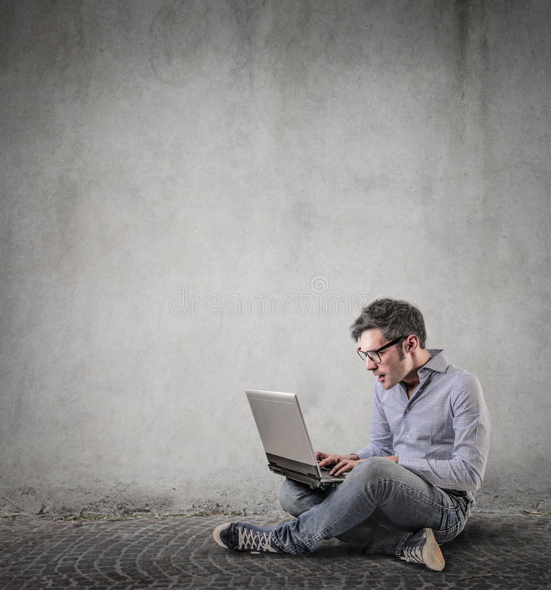 Download Surprised An Using His Laptop Stock Photo - Image: 39522945