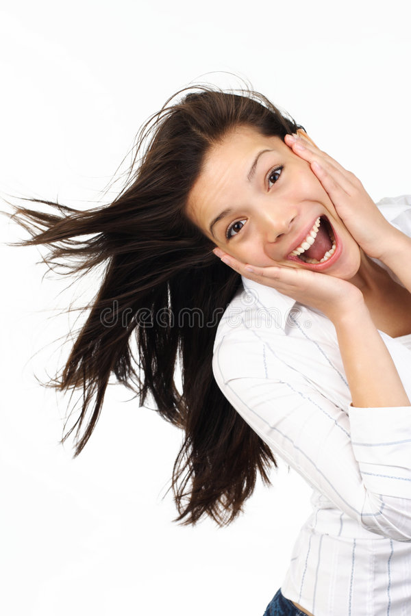 Surprised woman. Very happy and surprised eurasian woman holding her head in amazement royalty free stock images