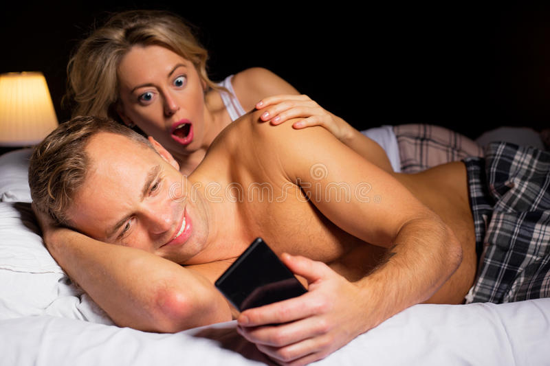 Surprised woman caught her man cheating stock photos