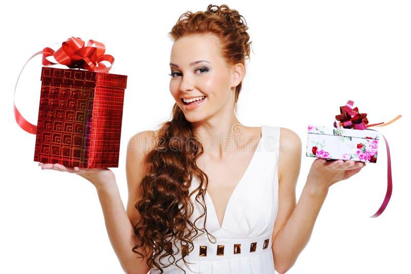 Surprised woman choosing presents royalty free stock image