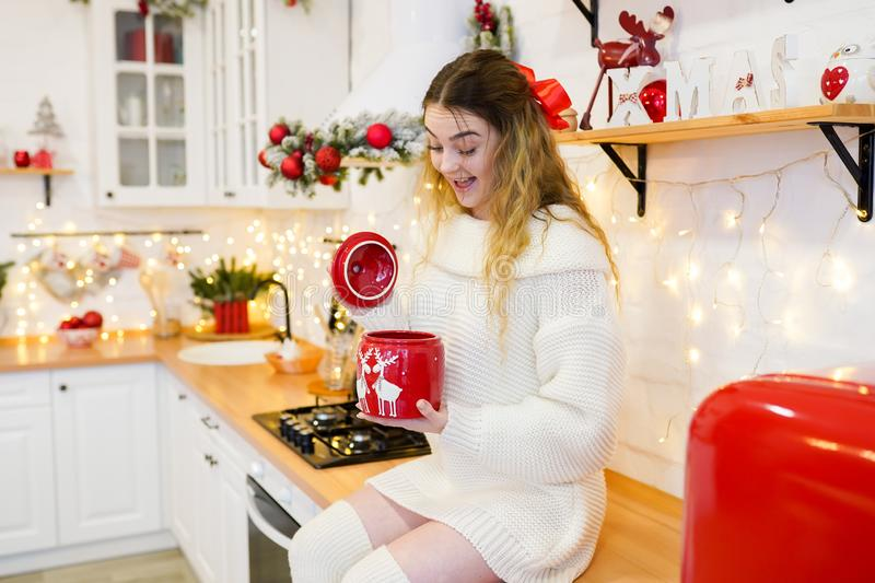 Surprised woman in christmas decorated kitchen royalty free stock photos