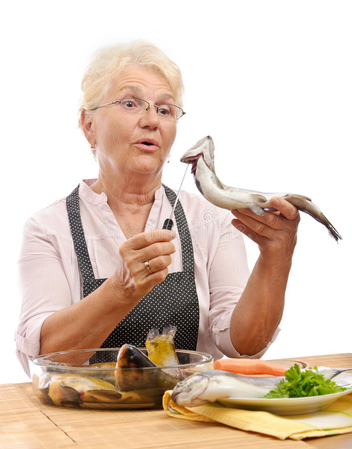 Download Surprised Woman Cooking Trout Stock Photo - Image: 20226874