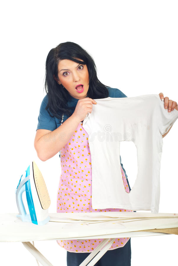 Surprised woman holding burned shirt stock photo