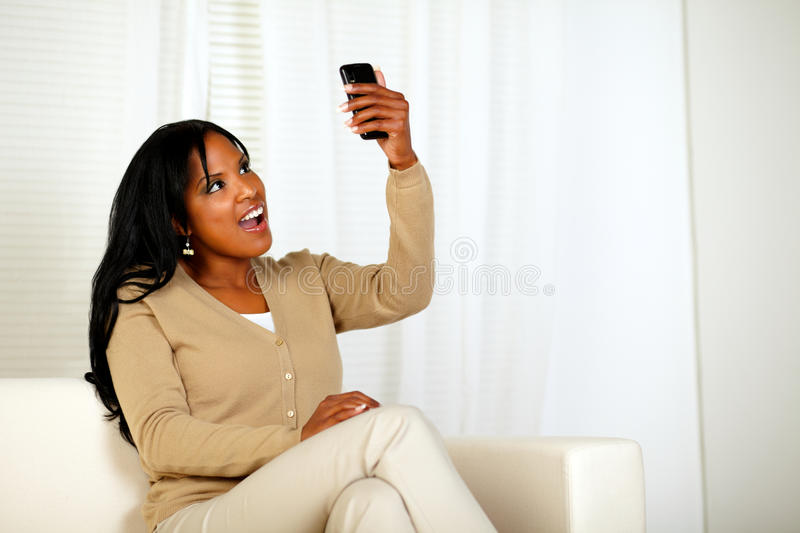 Surprised Woman Holding Her Cellphone Up Royalty Free Stock Photography
