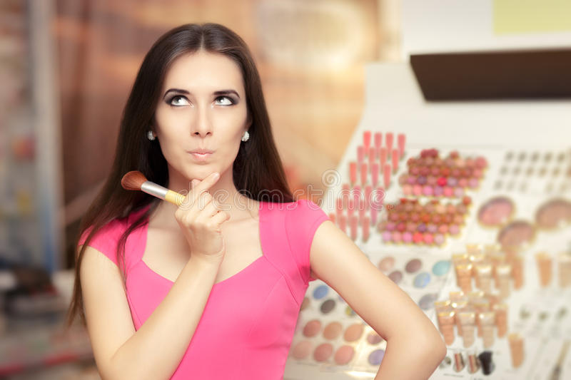 Surprised Woman Holding a Make-up Brush stock photos