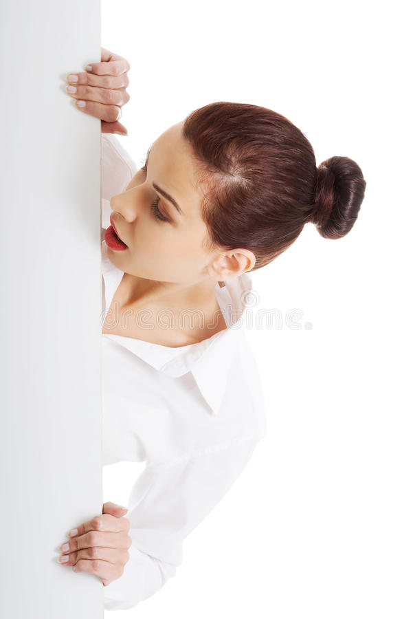 Surprised woman holding white empty banner.  royalty free stock images