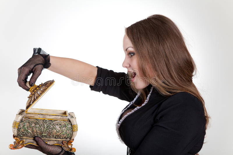 Surprised woman with jewelry box stock photos