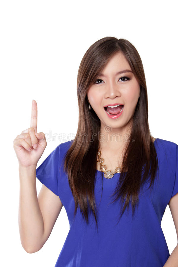Surprised woman pointing finger up stock photos