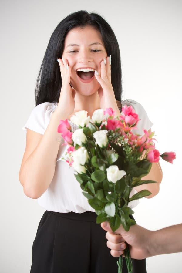 Surprised Woman Receiving Flowers stock photos