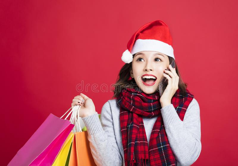 Surprised Woman shopping for christmas gifts stock image