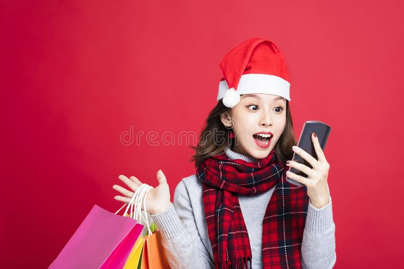 Surprised Woman shopping for christmas gifts royalty free stock photography