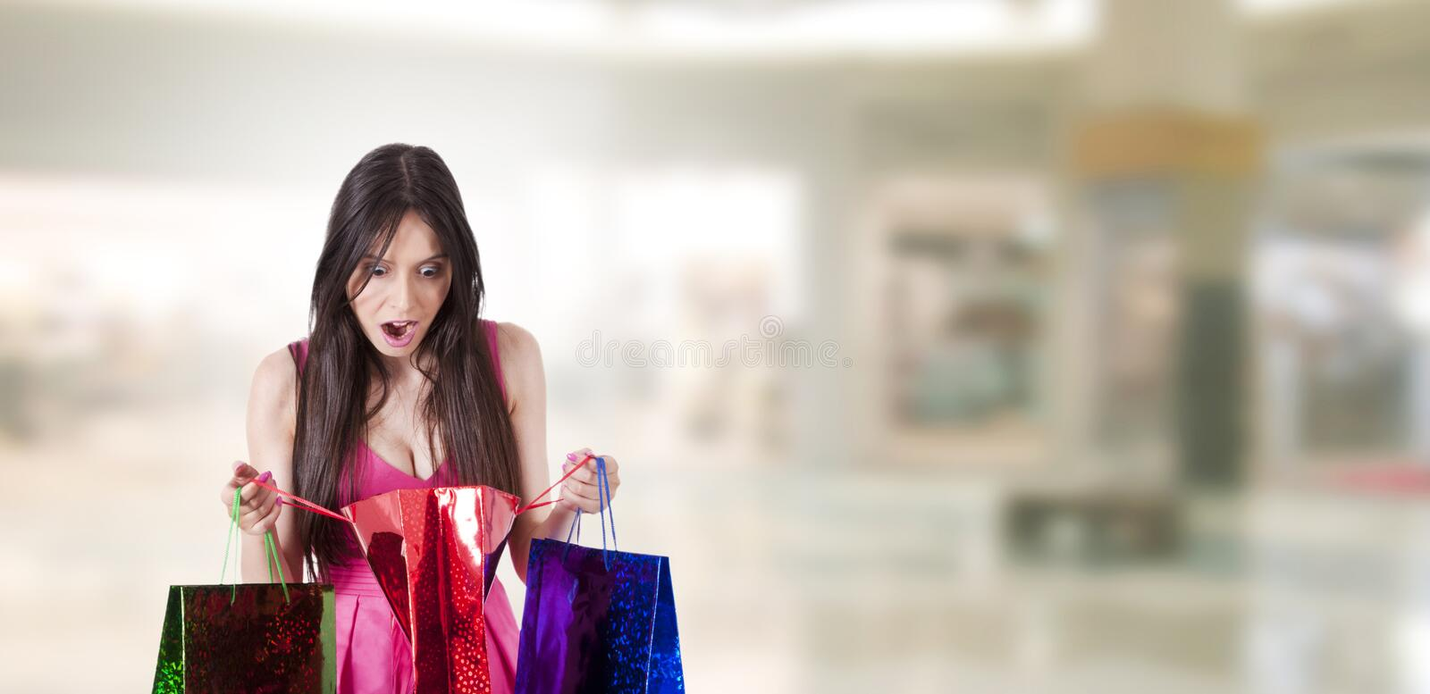 Surprised woman shopping royalty free stock images