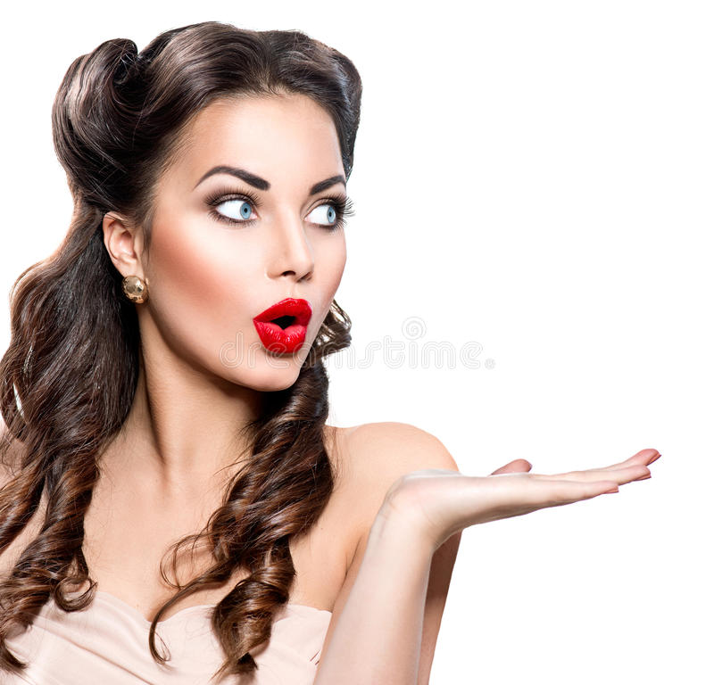 Surprised woman showing empty copy space. On the open hand royalty free stock photos