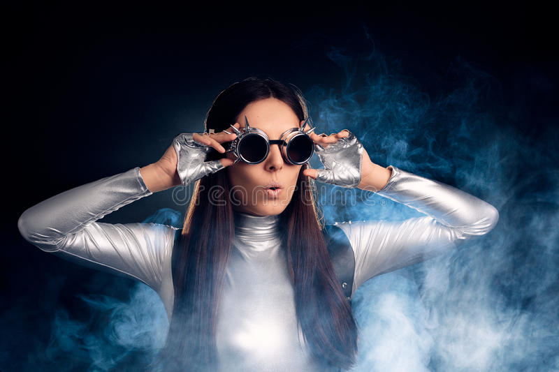 Surprised Woman in Silver Costume and Steampunk Glasses royalty free stock image